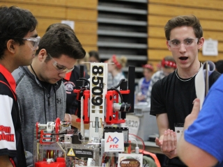 FIRST FTC Team #8509 The Steel Serpents getting their mostly 3D printed robot ready for competition.